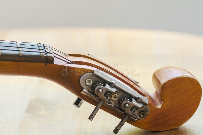 Neck of a stringed instrument mandoline part royalty free stock photos