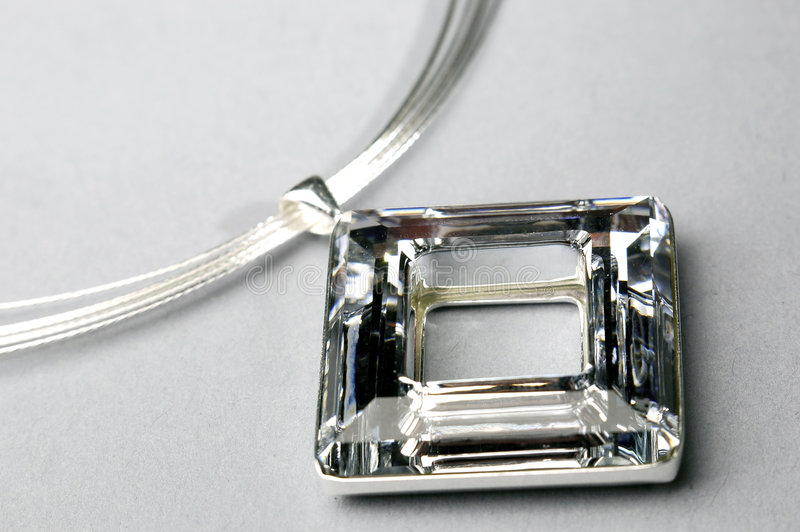 Necklace. Photo of shining necklace on the grey background royalty free stock photography