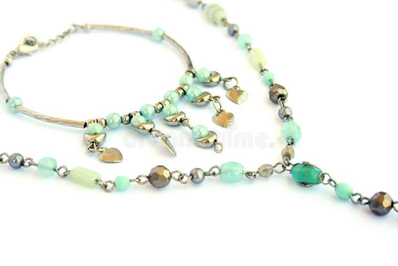 Necklace and bracelet. Isolated on white background stock photos