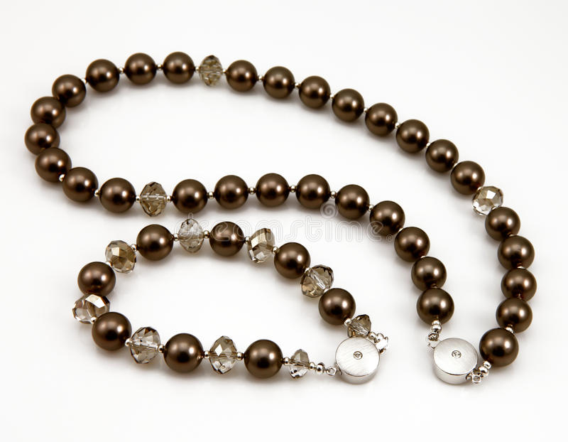 Necklace and bracelet. Closeup of a black pearl necklace and bracelet royalty free stock image