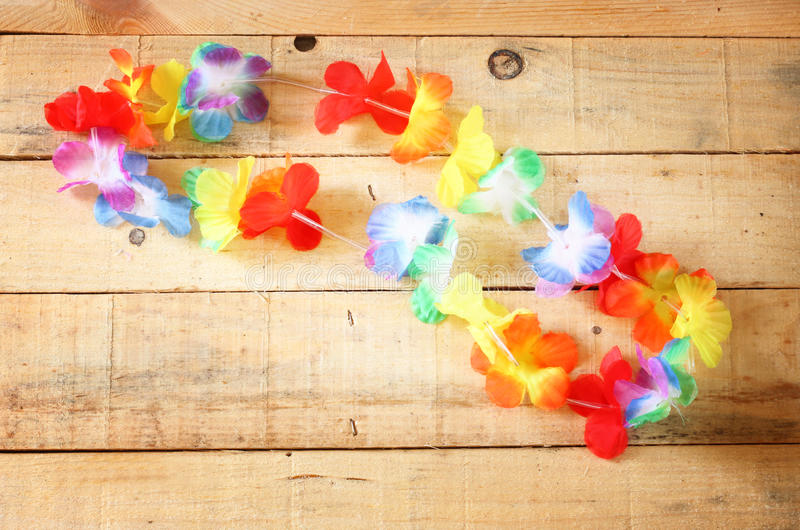 Download Necklace Of Bright Colorful Flowers Lei On Wood Background Royalty Free Stock Image - Image: 35743096