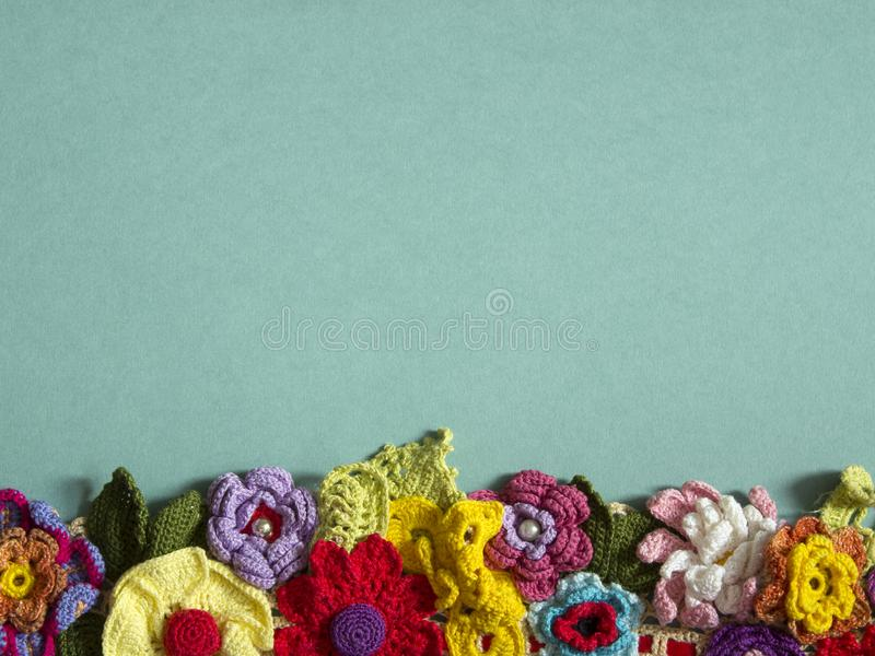 A necklace of colored crocheted flowers royalty free stock photos