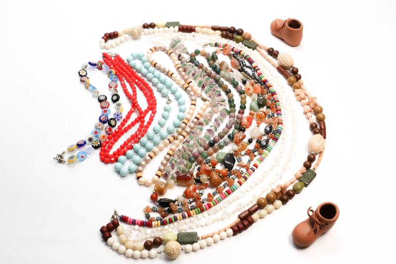 Necklace with Colorful Beads and Mini Boot Fashion Collection Presentation. Necklaces with Colorful Beads and Mini Boot Beautiful  Fashion Collection Concept royalty free stock image