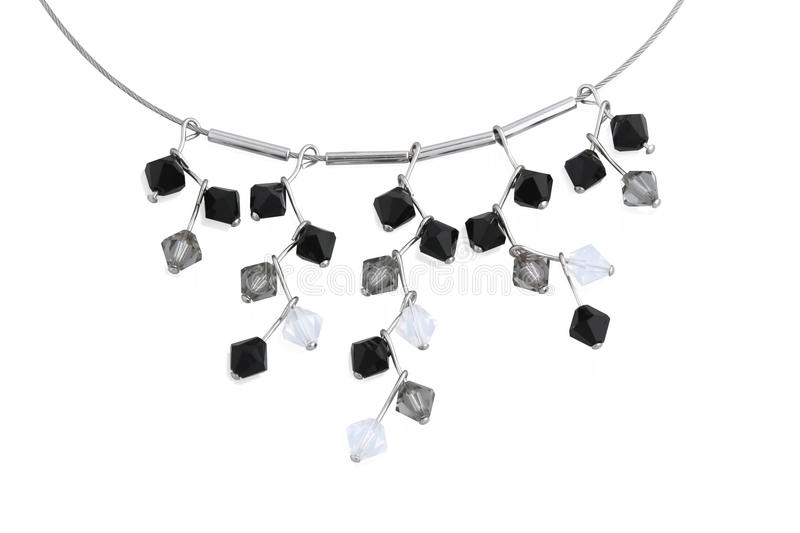 Necklace with crystals. Close up. Necklace with black, grey and white crystals isolated on white. Close up royalty free stock images