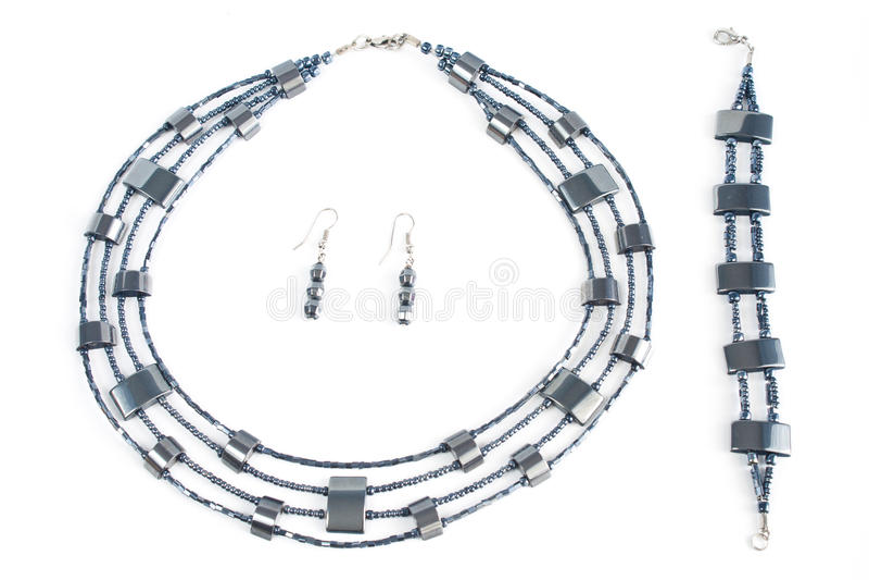 Necklace, earring, bracelet. Isolated on white background royalty free stock images