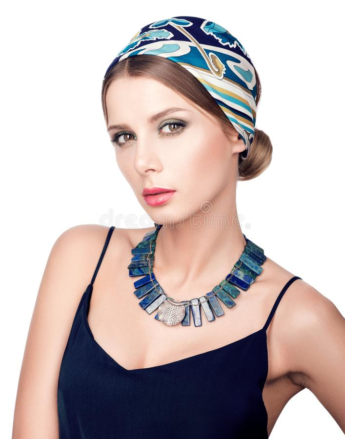Necklace and headscarf. Beauty portrait of young beautiful woman stock photography