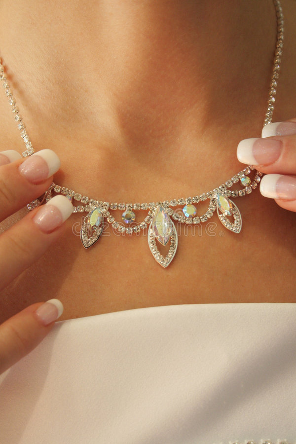 Necklace on a neck at the bride. stock photo