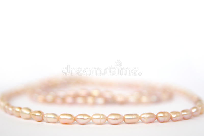 Necklace of pink river pearls royalty free stock photo