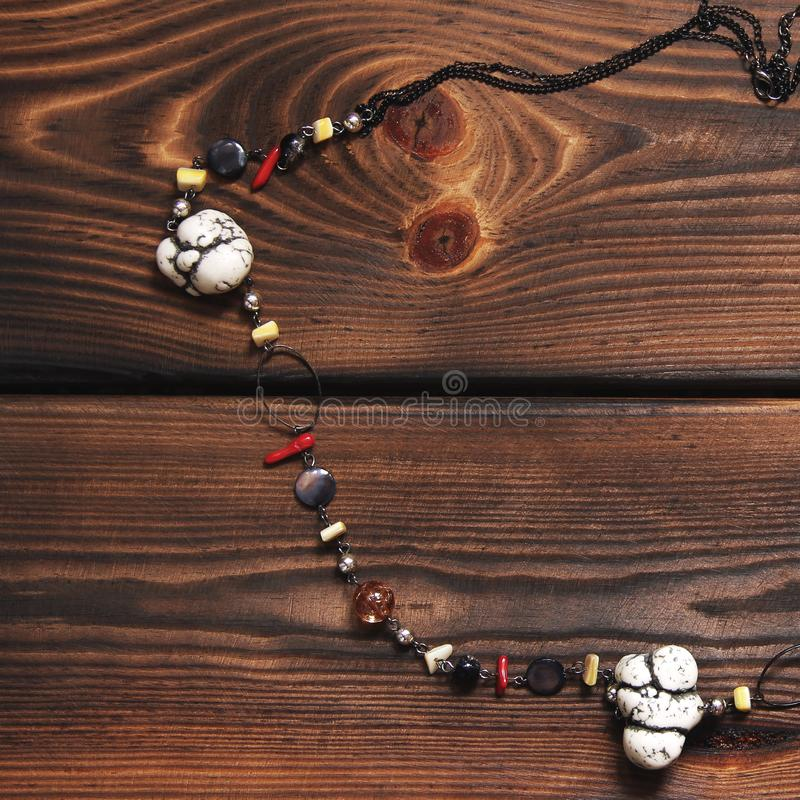 Necklace on wooden background royalty free stock photo