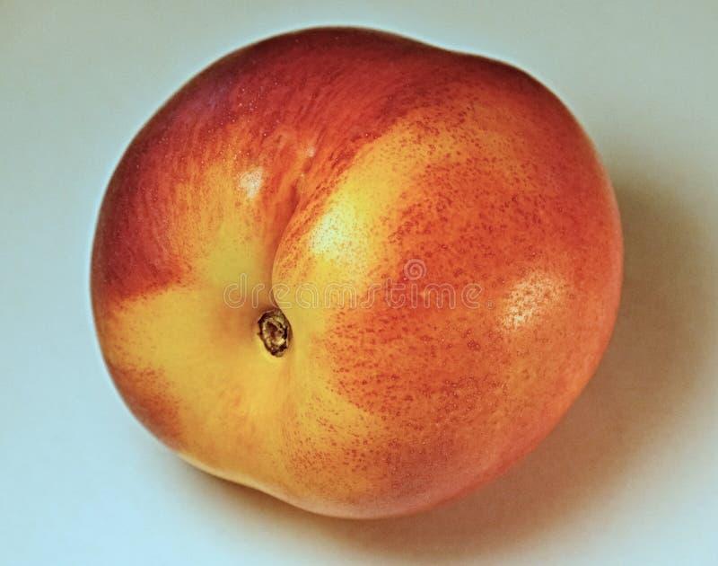 Nectarina, melocotón liso-pelado del Rosaceae de la familia que se crece en las regiones templadas más calientes del septentriona imagen de archivo