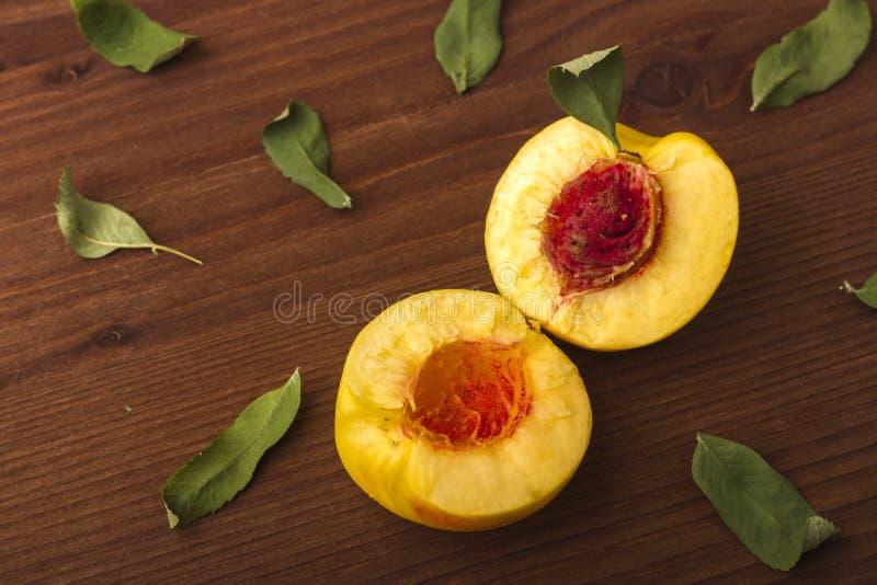 Nectarine is broken in half. stock image