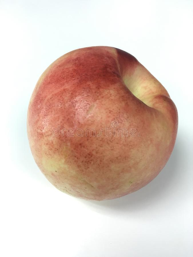 Nectarine fruit. On the white background royalty free stock image