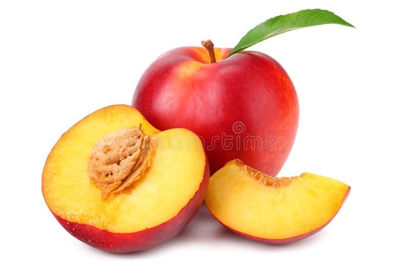 Nectarine with green leaf and slices isolated on white background royalty free stock photo