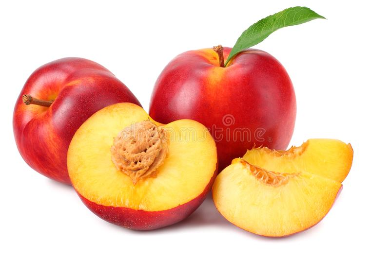 Nectarine with green leaf and slices isolated on white background stock photos
