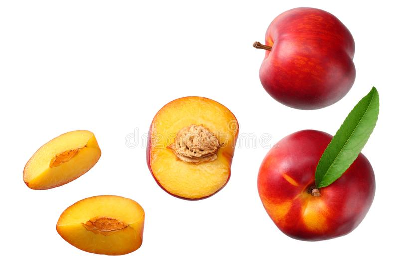 Nectarine with green leaf and slices isolated on white background. top view royalty free stock photo