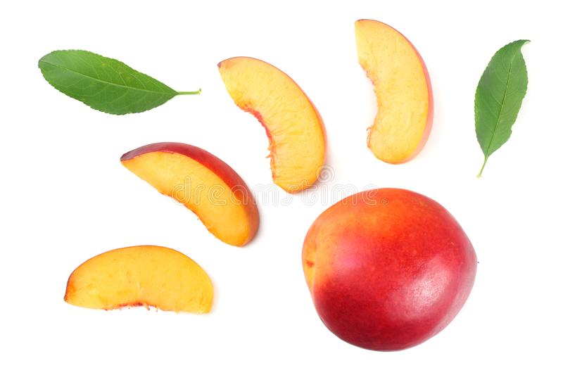 Nectarine with green leaf and slices isolated on white background. top view royalty free stock photography
