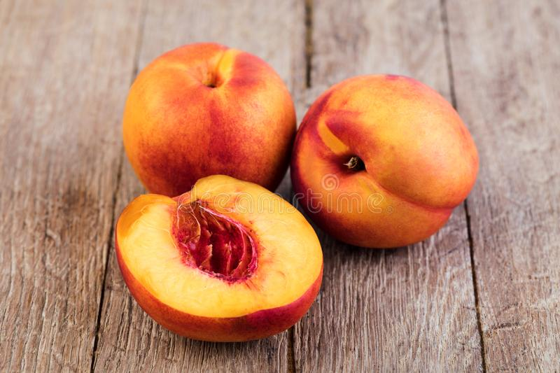Nectarine. Fruit on a wooden royalty free stock photos