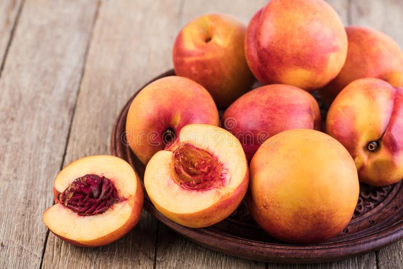 Nectarine. Fruit on a wooden stock photography