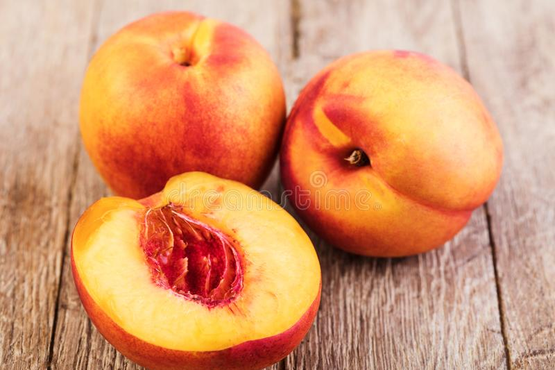 Nectarine. Fruit on a wooden royalty free stock image
