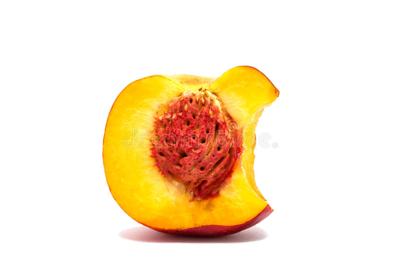 Nectarine peach isolated on a white background. Bitten royalty free stock image