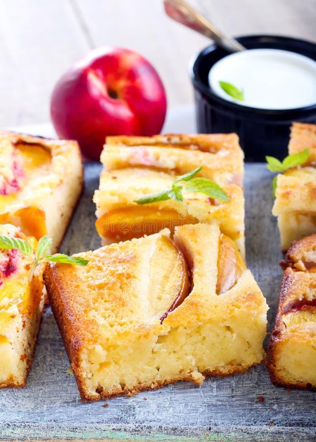 Nectarine polenta cake royalty free stock images