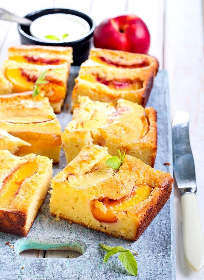 Nectarine polenta cake stock image