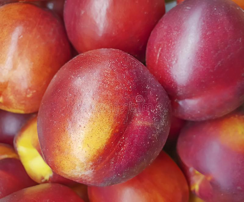 Nectarine ripe fruit background natural nutrition. Nectarine ripe fruit background,  natural nutrition royalty free stock images