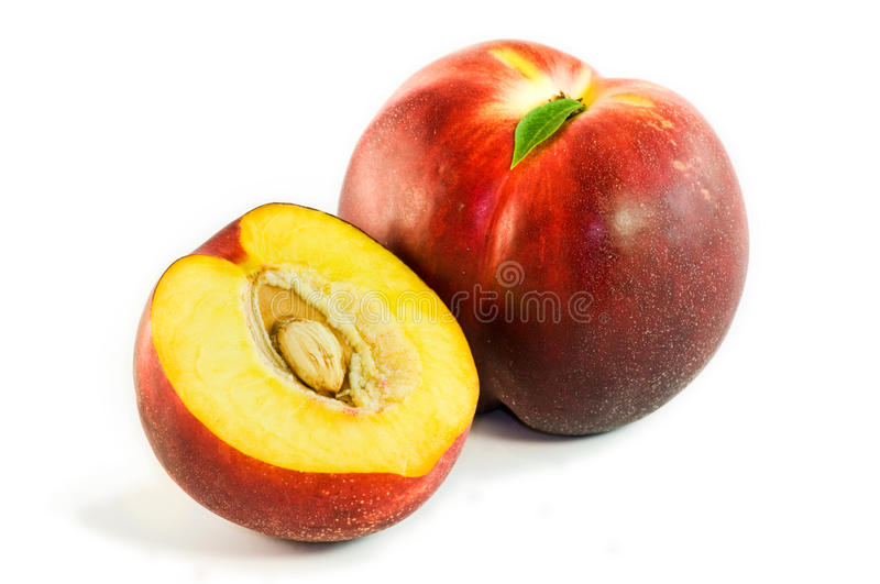 Nectarines. One and half nectarines isolated on a white background stock photos