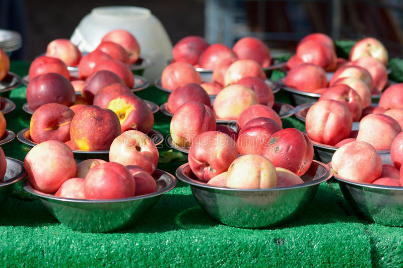 Nectarines in bowls at the bi-weekly fruit and vegetable market royalty free stock image