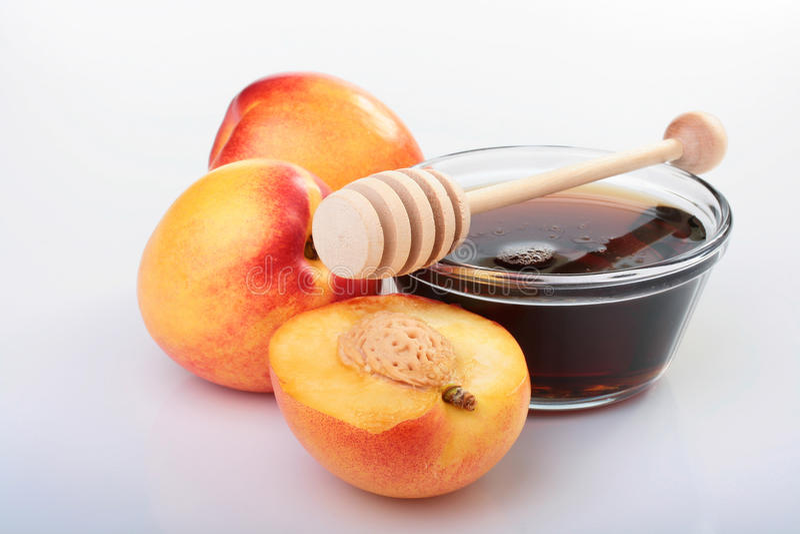Nectarines et miel image stock