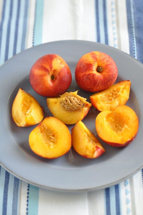 Nectarines. Fresh ripe nectarines on a plate stock photo