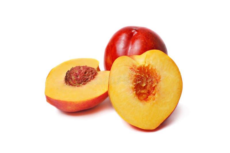 Nectarines isolated. Few nectarines isolated on a white background stock photo