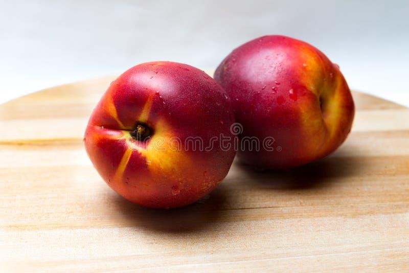 Nectarines. Isolated on white background stock image