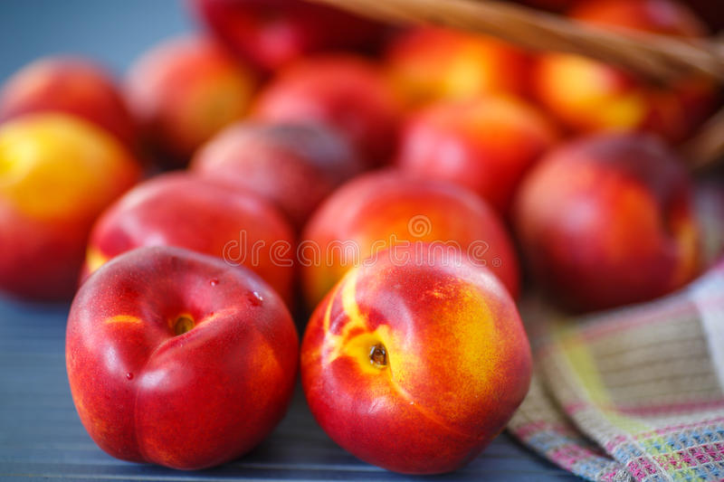 Nectarines. Ripe sweet nectarines on wooden table, close up royalty free stock photos