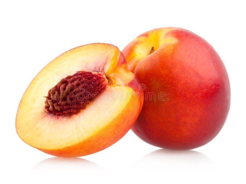 Nectarines. Ripe nectarines on white background royalty free stock images