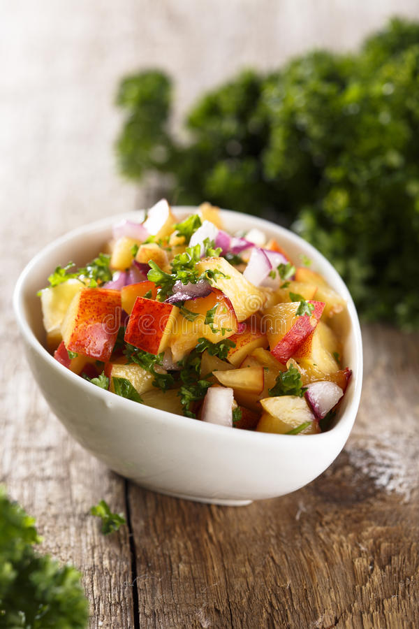 Nectarines salsa sauce. With parsley royalty free stock photo