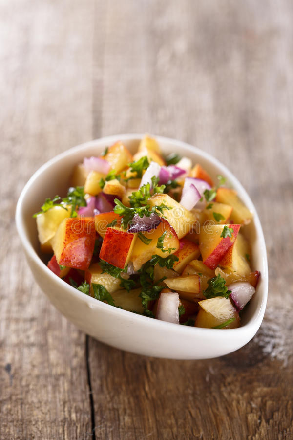 Nectarines salsa sauce. With parsley royalty free stock images