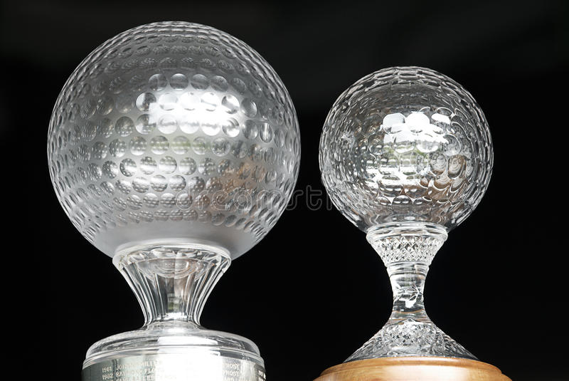 Nedbank Golf Challenge Trophy. Nedbank Golf Challenge trophies, side by side. The smaller of which is used for the Champions Challenge segment of the tournament royalty free stock image