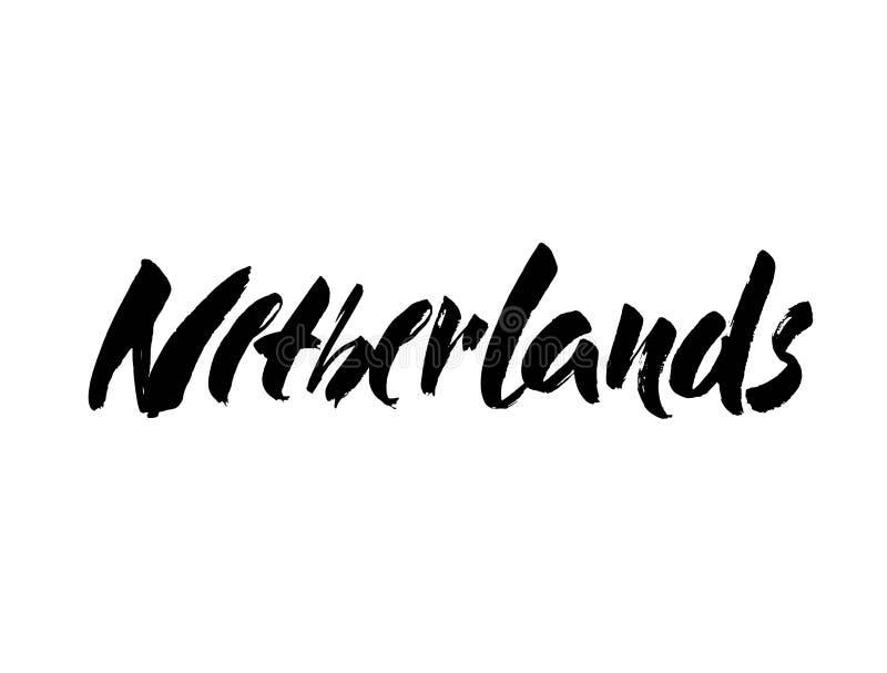 Nederland overhandigt getrokken inktborstel het van letters voorzien Kalligrafiewoord Nederland stock afbeelding