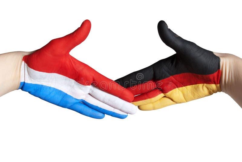 Nederlandse en Duitse handdruk royalty-vrije stock foto's