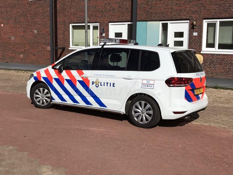 Nederlandse nationale politiewagen Volkswagen Touran royalty-vrije stock foto