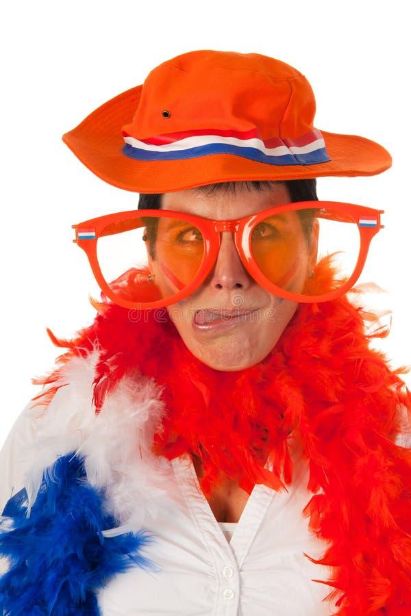 Nederlandse in sinaasappel als voetbalventilator stock afbeeldingen
