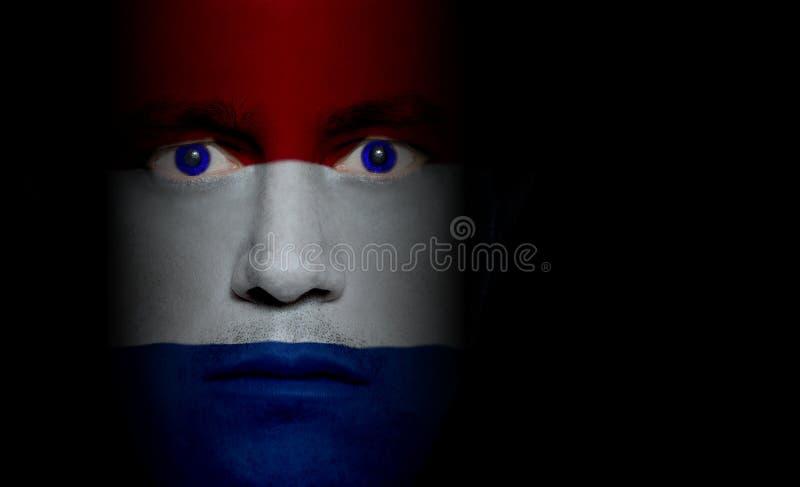 Nederlandse Vlag - Mannelijk Gezicht royalty-vrije stock foto