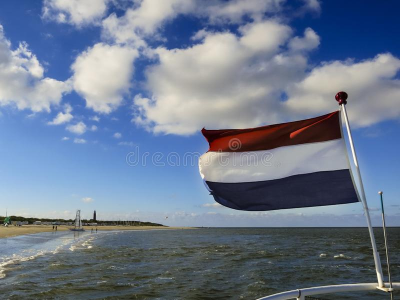 Nederlandse vlag in Texel stock foto