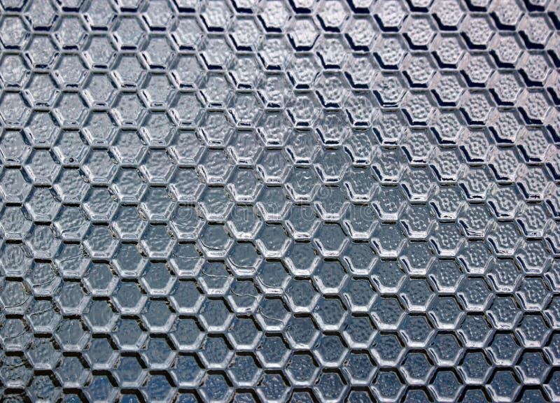 Nedfläckad texturerad semitransparent glass bakgrund arkivbilder