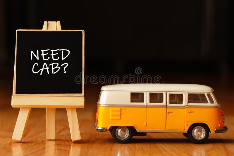 Need cab?. Yellow car with a text written on board need cab royalty free stock image