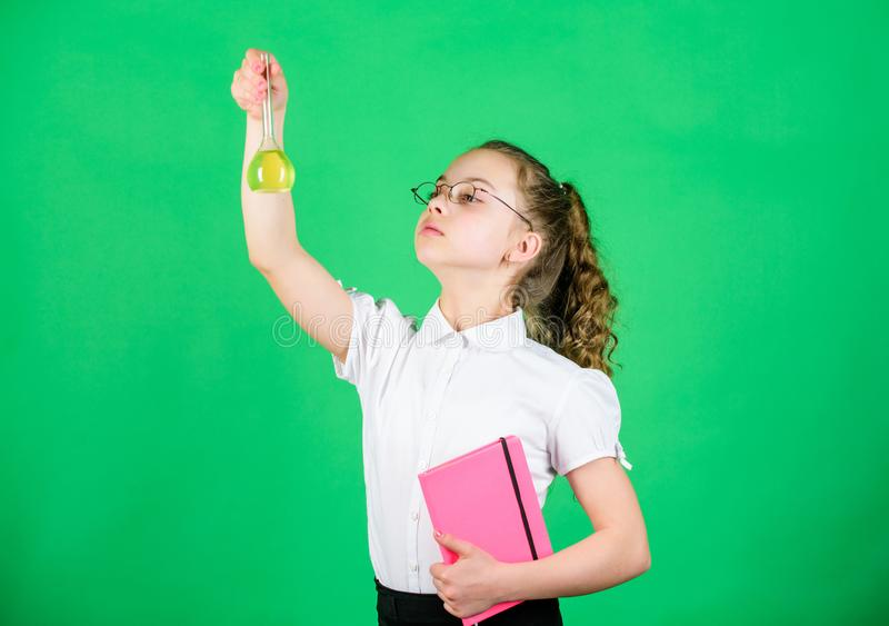 She need an expert advice. small smart girl with testing flask. back to school. science research in lab. Small school. Girl. education and knowledge. child stock photography