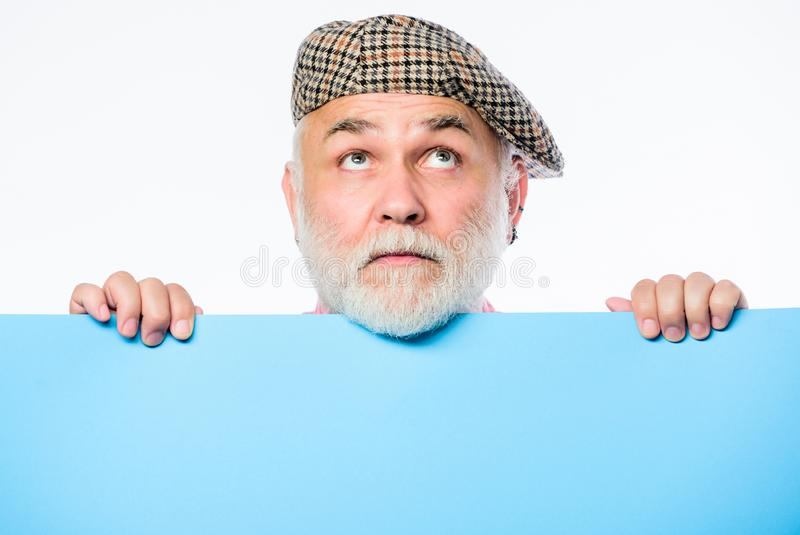 Need an inspiration. wanted. Copy space placate information. thinking mature man in retro hat. Senior bearded man place royalty free stock photos
