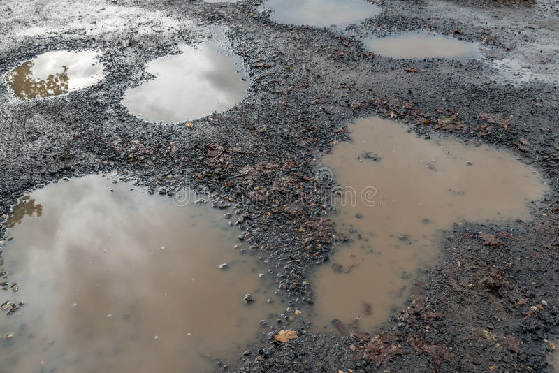 In need of repair. Image showing deterioration in roads royalty free stock photography