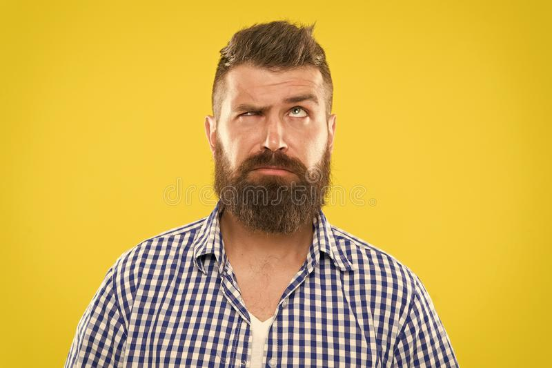 Need to think. Man serious face raising eyebrow not confident. Have some doubts. Hipster bearded face not sure in royalty free stock images